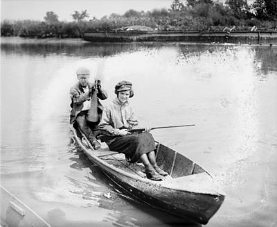 Woman With Cameras Photograph - Man And Woman In A Canoe, The Woman by Everett