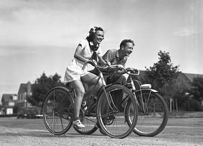 Man And Woman Riding Bicycles, (b&w), Art Print by George Marks