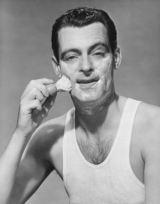 Man Applying Shave Foam On Face In Studio, (b&w), Portrait Art Print by George Marks