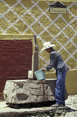 Photograph - Man At The Well Real De Catorce Mexico by John  Mitchell