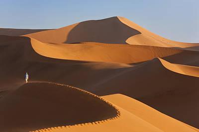 Man Climbing Sand Dunes, Namib Desert, Namibia Art Print