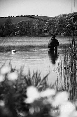 Man Flyfishing In A Lake In Ireland Art Print by Joe Fox