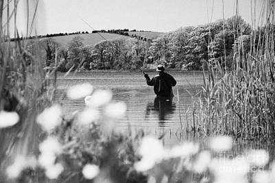 Man Flyfishing On Lake In Ireland Art Print by Joe Fox