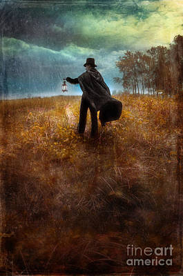 Man In Top Hat And Cape Walking In Rain Art Print by Jill Battaglia
