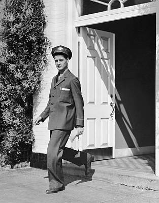 Man In Uniform Walking Out Door Art Print by George Marks