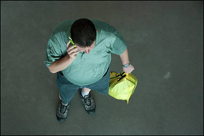 Photograph - Man Making Phone Call by Werner Hammerstingl