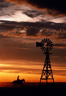 Working Cowboy Photograph - Man On Horse, Riding Past Wind Turbine, Silhouetted At Sunset by Kathi Lamm