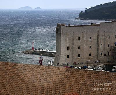 Man On The Roof In Dubrovnik Art Print by Madeline Ellis