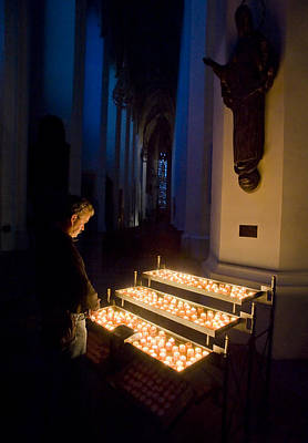 Man Prays By Candles At Frauenkirche Art Print by Greg Dale