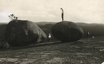 Man Stands Atop A Huge Boulder On Bald Art Print by Herbert E. Gregory
