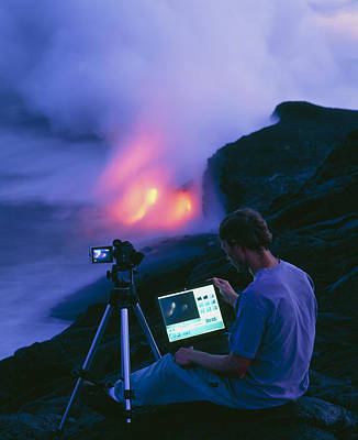 Man Taking Photographs Of A Lava Flow Art Print by G. Brad Lewis