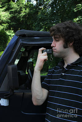 Drunk Driving Photograph - Man Using A Breathalyzer by Photo Researchers, Inc.