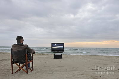 Man Watching Tv On Beach At Sunset Art Print by Sami Sarkis