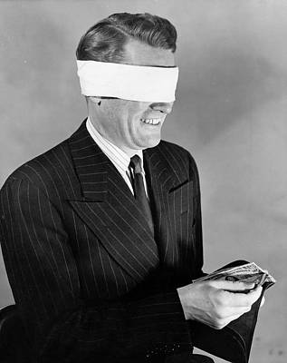 Man Wearing Blindfold Holding Money (b&w) Art Print by Hulton Archive