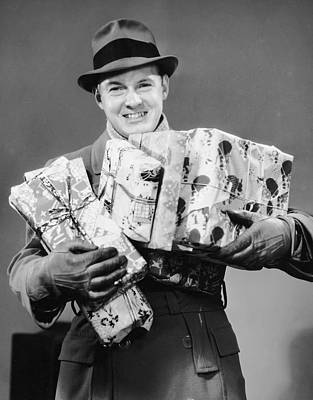 Man With Coat, Gloves And Hat Carrying Christmas Gifts Art Print by George Marks