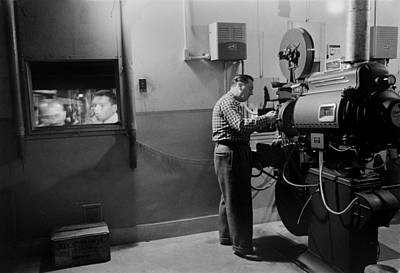 Man Working A Projector In A Movie Print by Everett