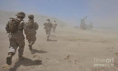 Marines Move Through A Dust Cloud Art Print by Stocktrek Images