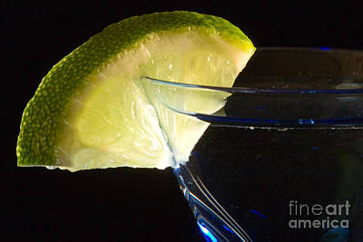 Martini Cocktail With Lime Wedge On Blue Glass Art Print