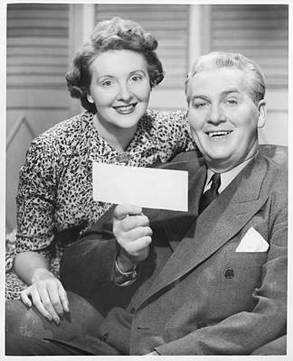 Mature Couple Posing, Man Holding Check, (b&w), Portrait Art Print by George Marks