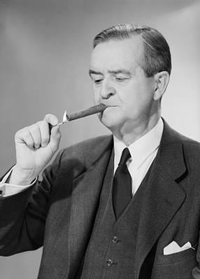 Mature Man Lighting Cigar Art Print by George Marks