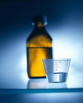 Cough Syrup Photograph - Medicine Bottle And Cup by Tek Image