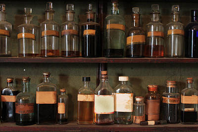 Row Of Bottles Photograph - Medicine Bottles In Pharmacist's Shop by Ben Robson