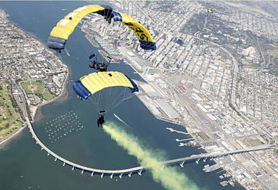 Members Of The U.s. Navy Parachute Team Art Print by Stocktrek Images