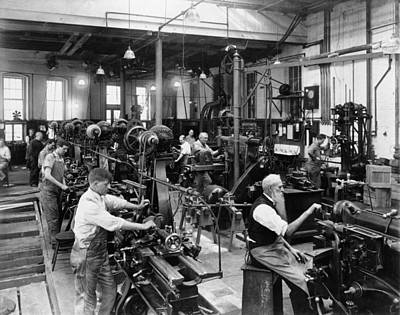 Mechanization Photograph - Men Working At Machines by Everett