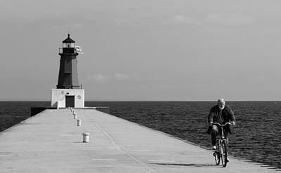 Photograph - Meominee Lighthouse Biker In Black And White by Mark J Seefeldt