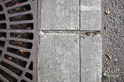 Metal Grate On Sidewalk Art Print by Paul Edmondson