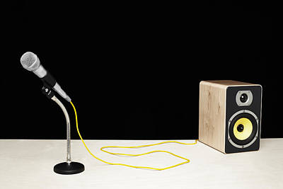 Microphone With Yellow Cable Plugged Into Speaker Art Print by Microzoa