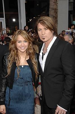 Fringe Jacket Photograph - Miley Cyrus Wearing An Alberta Ferretti by Everett