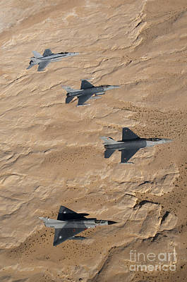 Photograph - Military Fighter Jets Fly In Formation by Stocktrek Images