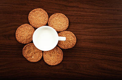 Milk And Cookies On Table Art Print by Elias Kordelakos Photography