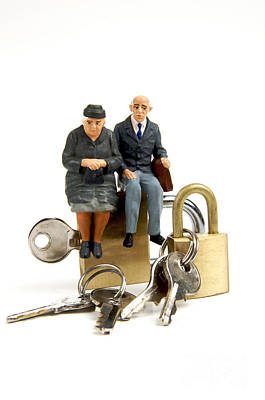 Miniature Figurines Of Elderly Couple Sitting On Padlocks Art Print by Bernard Jaubert