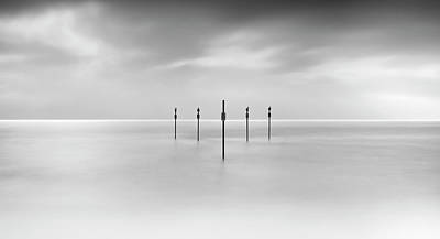 Minimal Posts Are Arranged Symmetrically In Sea Art Print by Doug Chinnery