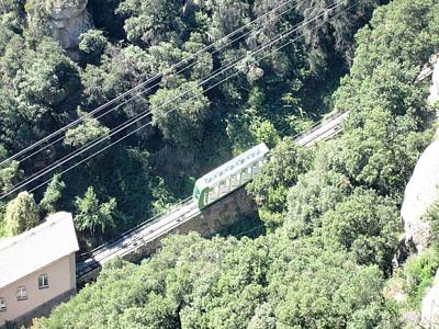 Photograph - Montserrat Monastery Tram Cable Car Heading Down The Mountain Near Barcelona Spain by John Shiron