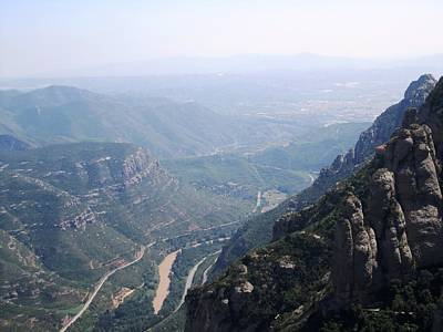 Photograph - Montserrat View As Far As Eye Can See In A Hazy Day At High Altitude In Spain Near Barcelona by John Shiron