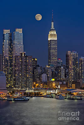 Moonrise Along The Empire State Building Art Print by Susan Candelario