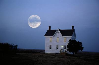 Moonrise Over A Solitary Building Which Art Print