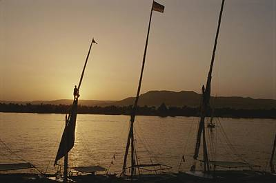 Moored Feluccas On The Nile River Print by Kenneth Garrett