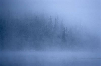 Morning Mist Rises Off A Lake Art Print by Kenneth Ginn
