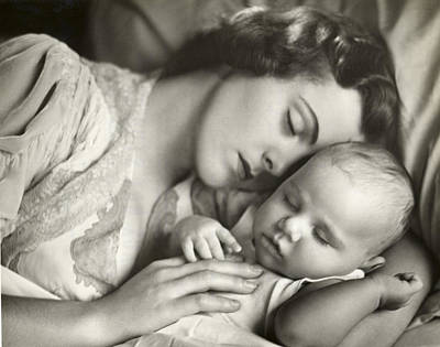 Mother Holding Infant In Bed Art Print by George Marks