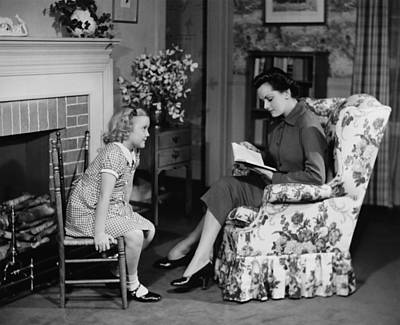 Mother Reading To Daughter (6-7) In Living Room, (b&w) Art Print by George Marks