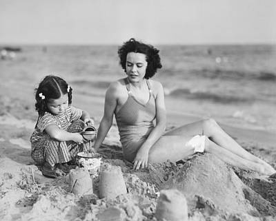 Mother With Girl (2-3) Playing In Sand On Beach, (b&w) Art Print by George Marks