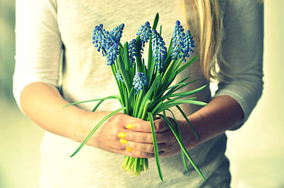Muscari In Womans Hands Art Print by Photo by Ira Heuvelman-Dobrolyubova