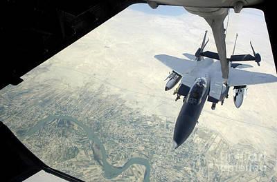 N F-15e Strike Eagle Receives Fuel Art Print by Stocktrek Images