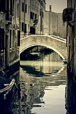 narrow channel with a bridge in Venice Art Print