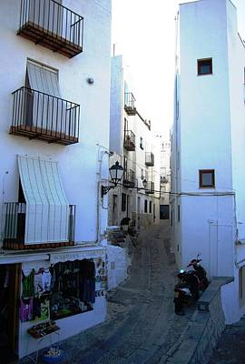 Photograph - Narrow Stone Paved Street Leads To Peniscola Castle High Above In Spain by John Shiron