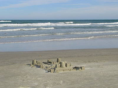 Photograph - New Smyrna Sand Castle by RobLew Photography